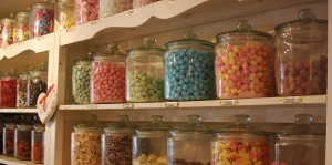 Shelf of jars filled with sweets